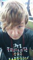 Ashton Deroy In a Spencer's T-shirt